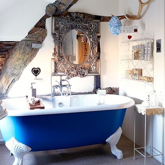 Modern Bathroom Design with Blue Clawfoot Tub Antique Mirror Natural Wood Accents