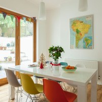 Dining room with multi-coloured chairs | Decorating ...