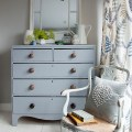 This country bedroom has a relaxed scandi vibe with a painted chest