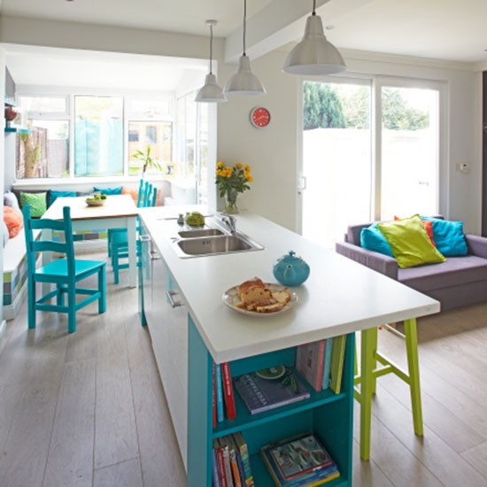 White kitchen with turquoise chairs  Decorating