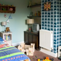 Boys' bedroom with feature wallpaper | Boys bedroom ideas ...