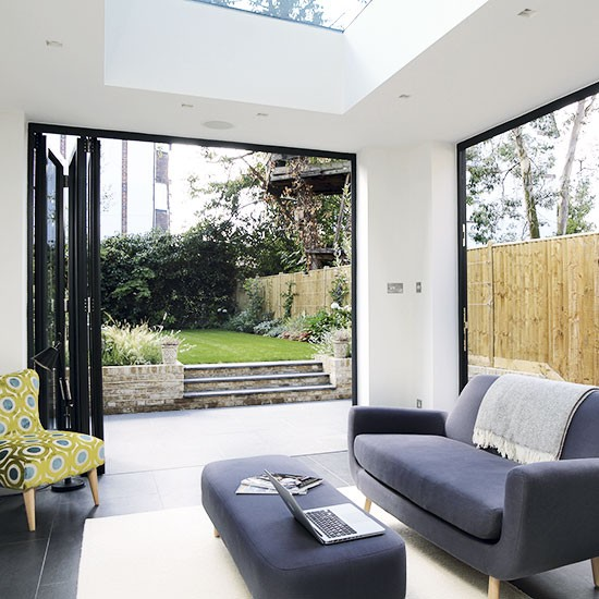 Modern living room with bifold doors  Decorating