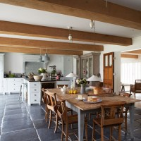Farmhouse-style kitchen diner with large wooden dining ...