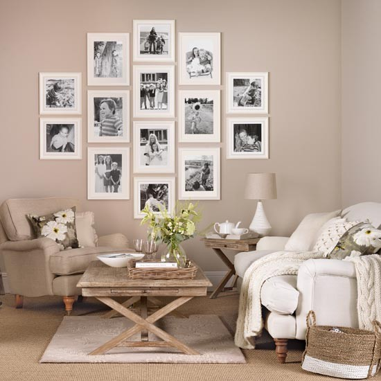 Neutral living room with family picture gallery  Simple