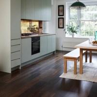 Junckers dark wood floor with pale green kitchen | Wood ...
