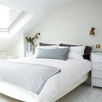 Modern white attic bedroom with cool accents