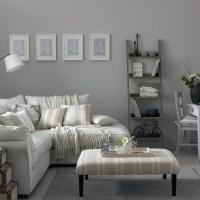 Grey living room with corner sofa and modern artwork