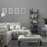 Grey living room with corner sofa and modern artwork ...