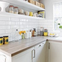 White kitchen with metro tiles and open shelves ...