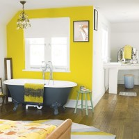 Bedroom with yellow painted feature wall | Bedroom paint ...