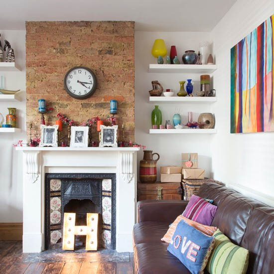 Modern living room with exposed brick chimeny breast