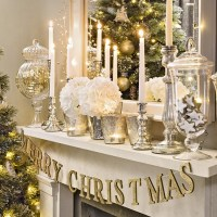 Christmas living room with silver and gold mantel display ...