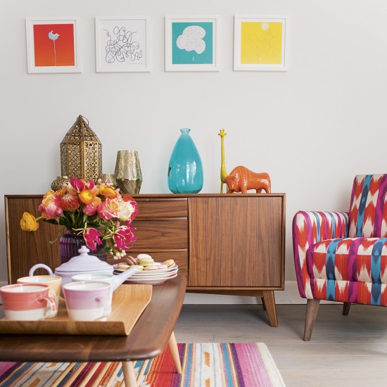 Modern living room with retro sideboard and pink and blue
