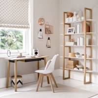 Pale grey home office with compact desk and utility ...