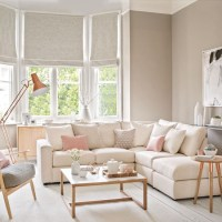 Pale and pretty living room with copper floor lamp ...