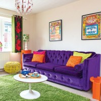Colourful modern living room with purple sofa and green ...