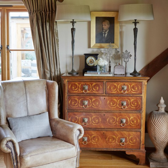 Country sitting room with antique dresser and twin lamps