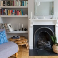 Cosy living room corner with traditional fireplace ...