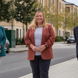 Three people stood in a residential street in South West England.