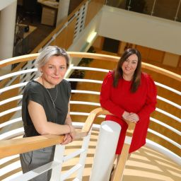 Jenny Allinson (l), Bernicia's new director of corporate governance, and Lindsay Muers (r), its new assistant director of people services. They are stood on a spiral staircase looking up at the camera.