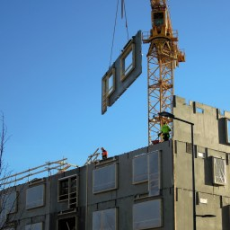 A modular building being lifted into place.
