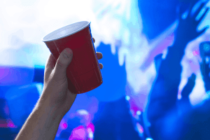 Minors consuming alcohol at a party.