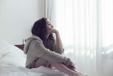 Woman contemplating her fibroid problem in Houston Texas