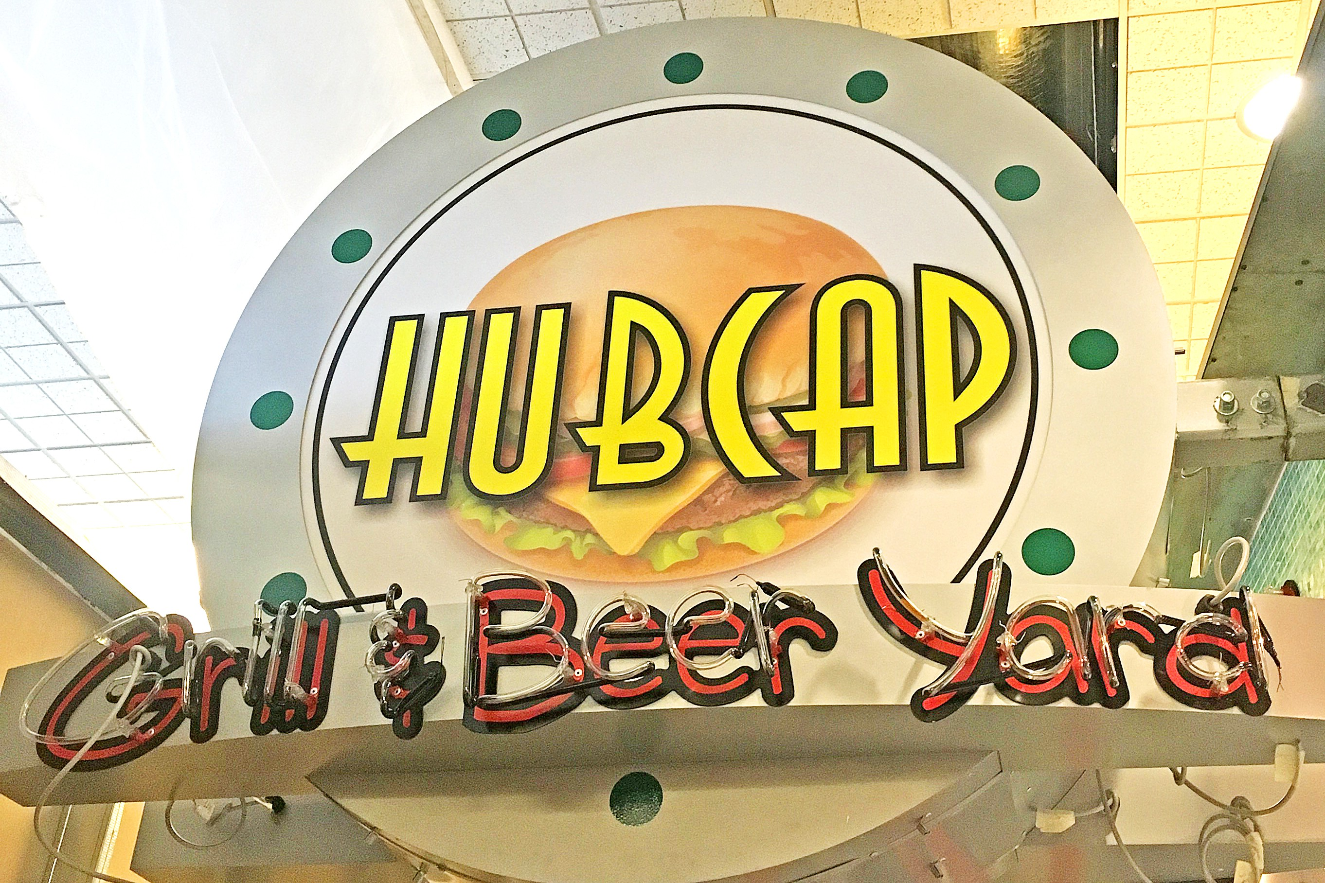hubcap grill sign at iah