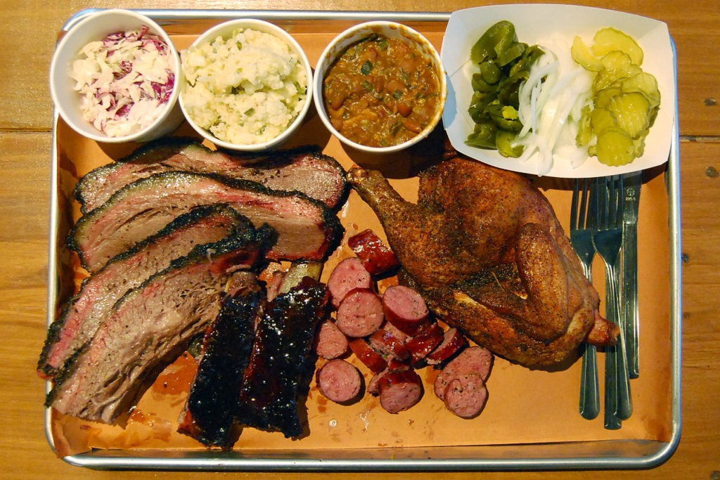 Brisket, glazed ribs, jalapeño sausage, smoked chicken, coleslaw, jalapeño cheese rice, and South Texas beans. Photo by Scott Sandlin.