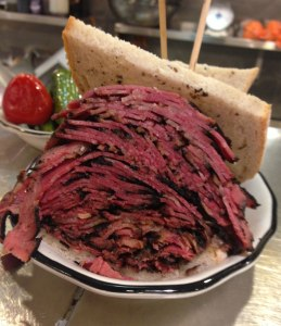 Picture of a huge hot pastrami sandwich.