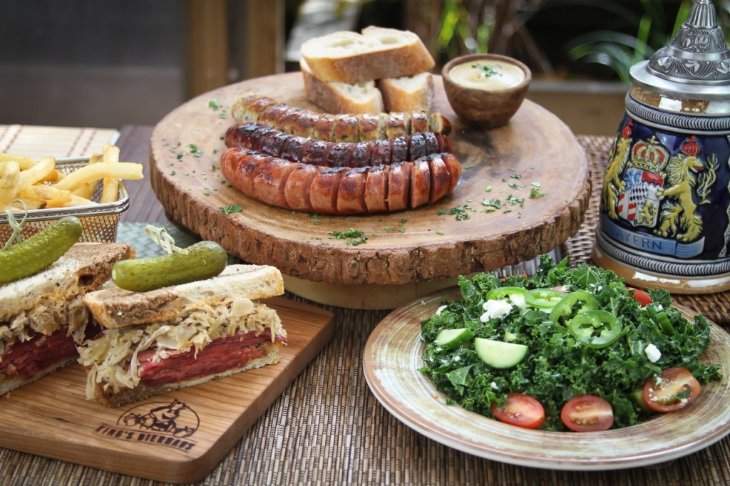 Picture of a Reuben sandwich and variety of sausages.