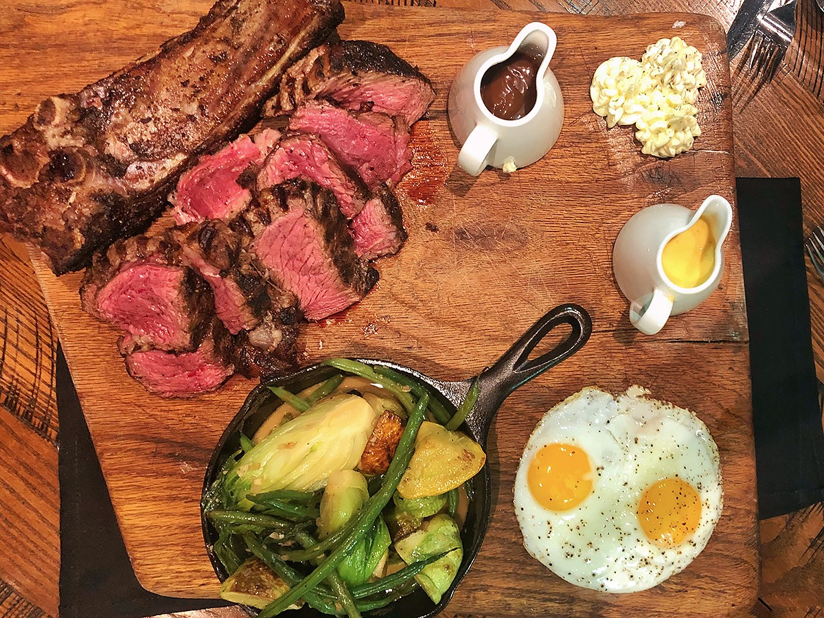 44 farms ribeye with grilled vegetables and fried eggs at Riel