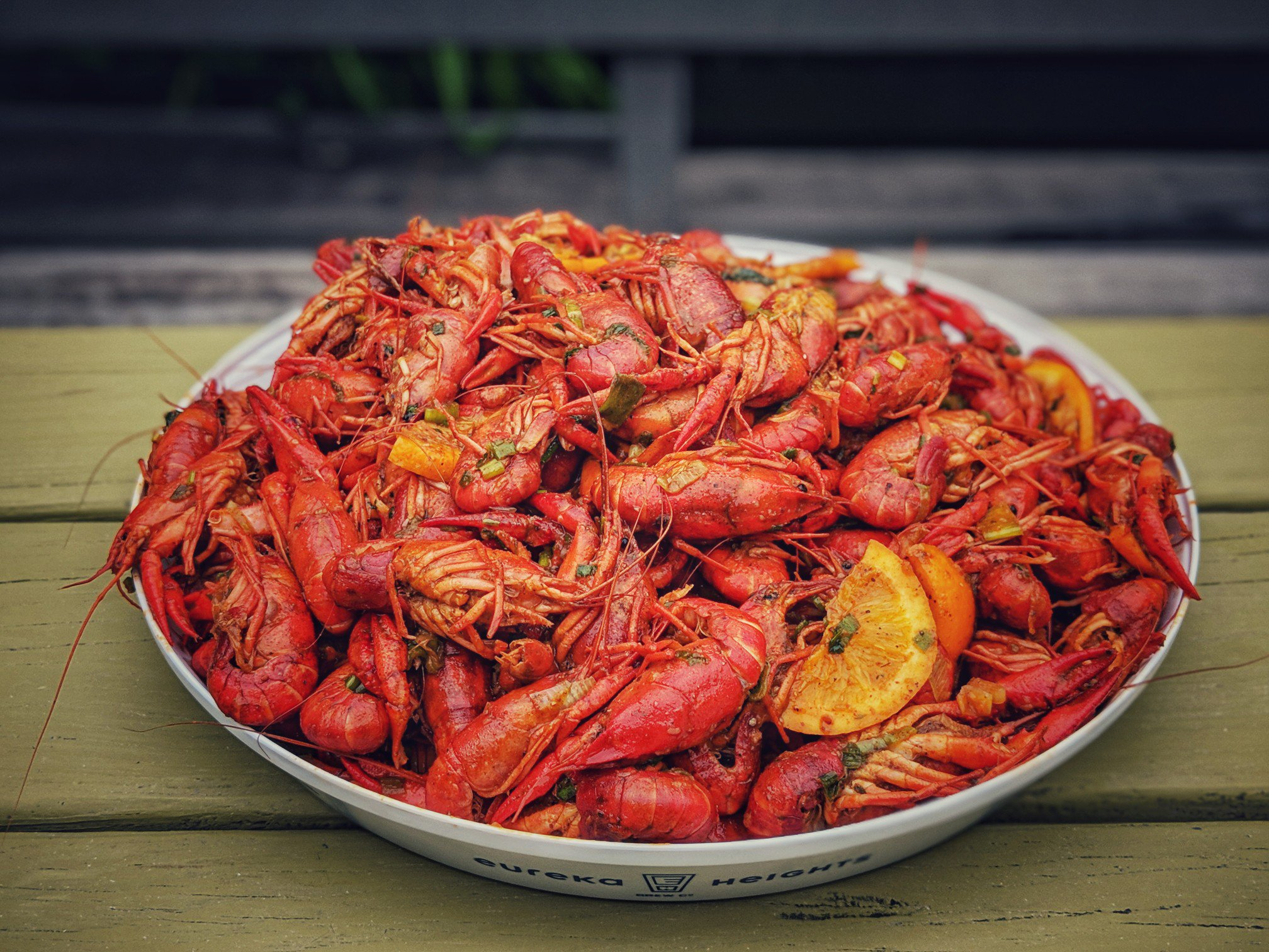 Large round platter of cooked crawfish.