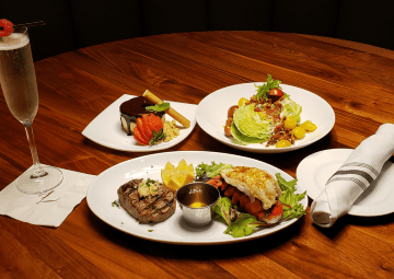 Selection of elegant plated dishes and prosecco