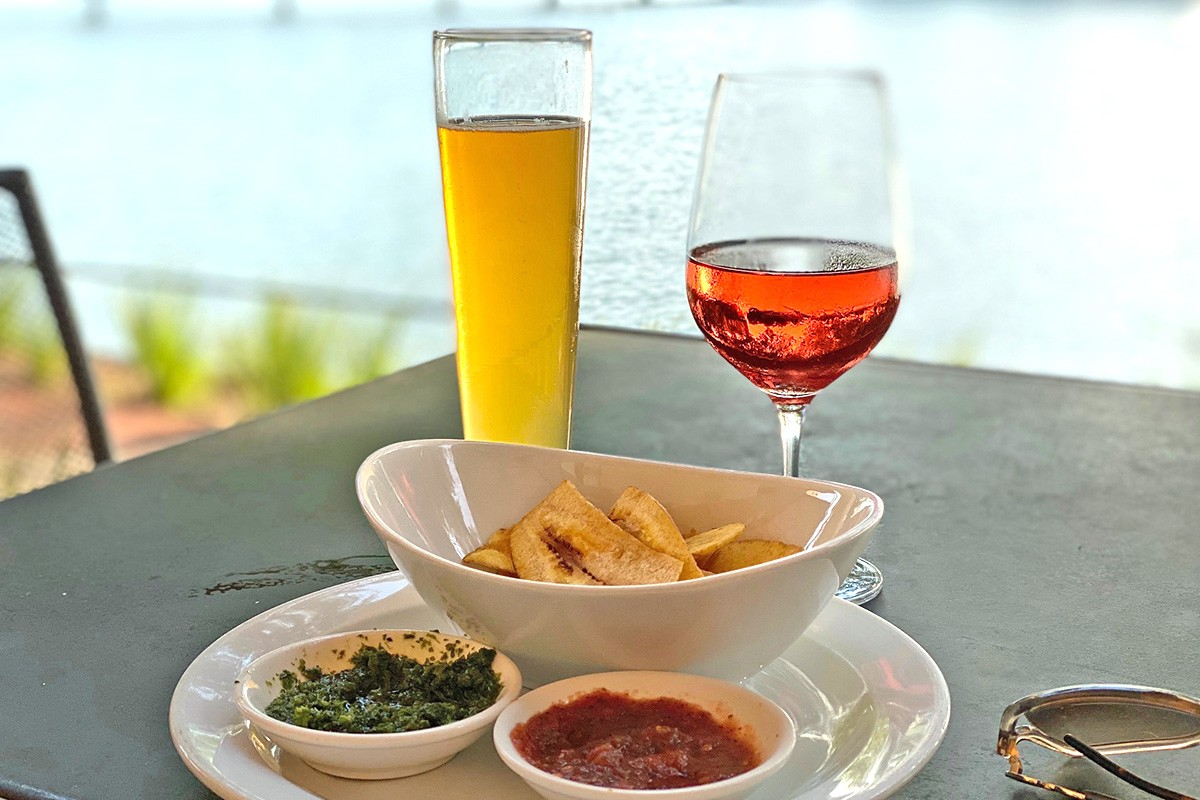 wine and plantain chips with a waterfront view at Churrascos in Sugar Land