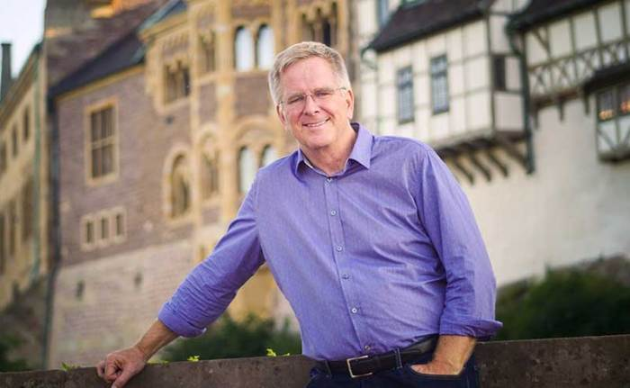 Public television personality Rick Steves in front of the Wartburg Castle in Germany.