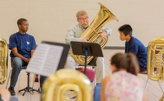 David Kirk, principal tuba, performs with Houston-area students.