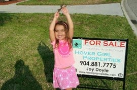 Little Girl in Front of For Sale Sign