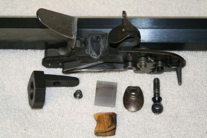 The fired flintlock is now disassembled and ready for cleaning.