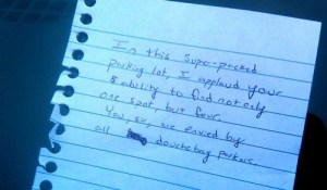 four parking spaces windshield note