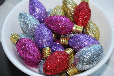 Burnt out Christmas lights dipped in glue and glitter.. put them in a glass far