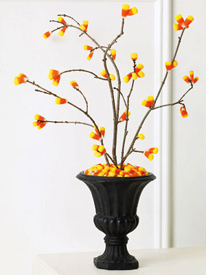 I love this idea just find some clean twigs from outside and hot glue candy corn