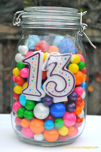 Birthday centerpiece idea for any age — tie balloons on top–fill with any cand