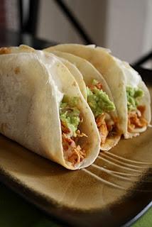 Dump 1 envelope of taco seasoning, 6 boneless, skinless chicken breasts a jar of