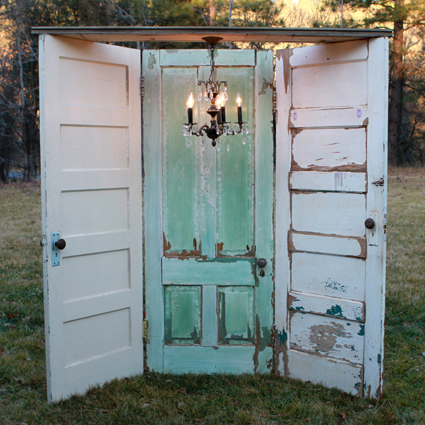 A different kind of photobooth backdrop – chandelier with three hinged doors