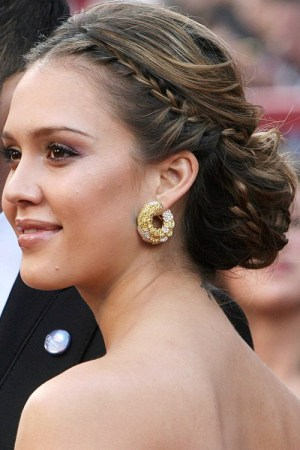messy bun hairstyle with a braided element