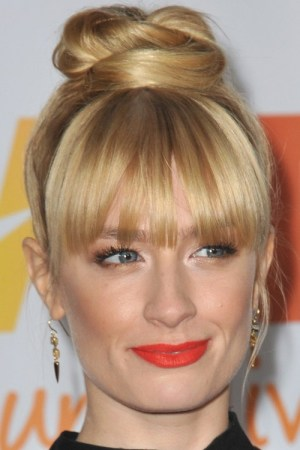 messy bun hairstyle with bangs