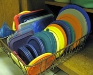 Use a dish drain from the dollar store to organize plastic lids. Seriously, this
