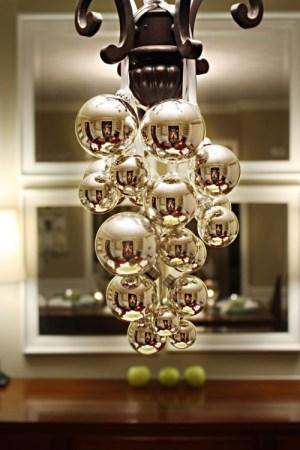 Simple bulbs and ribbon on a chandelier (via momsbyheart)