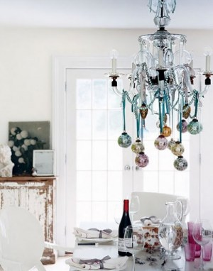 Ornaments hanging from a chandelier instead of a tree (via alovelyescape)